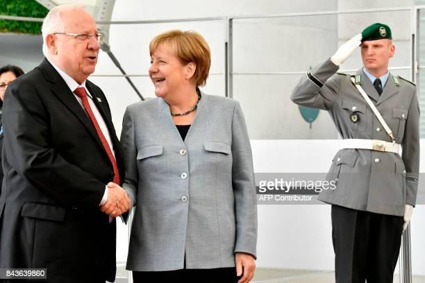 German Chancellor Angela Merkel shakes hands with Israeli President Reuven Rivlin at the chancellery in Berlin on September 7 2017 / AFP PHOTO / John...