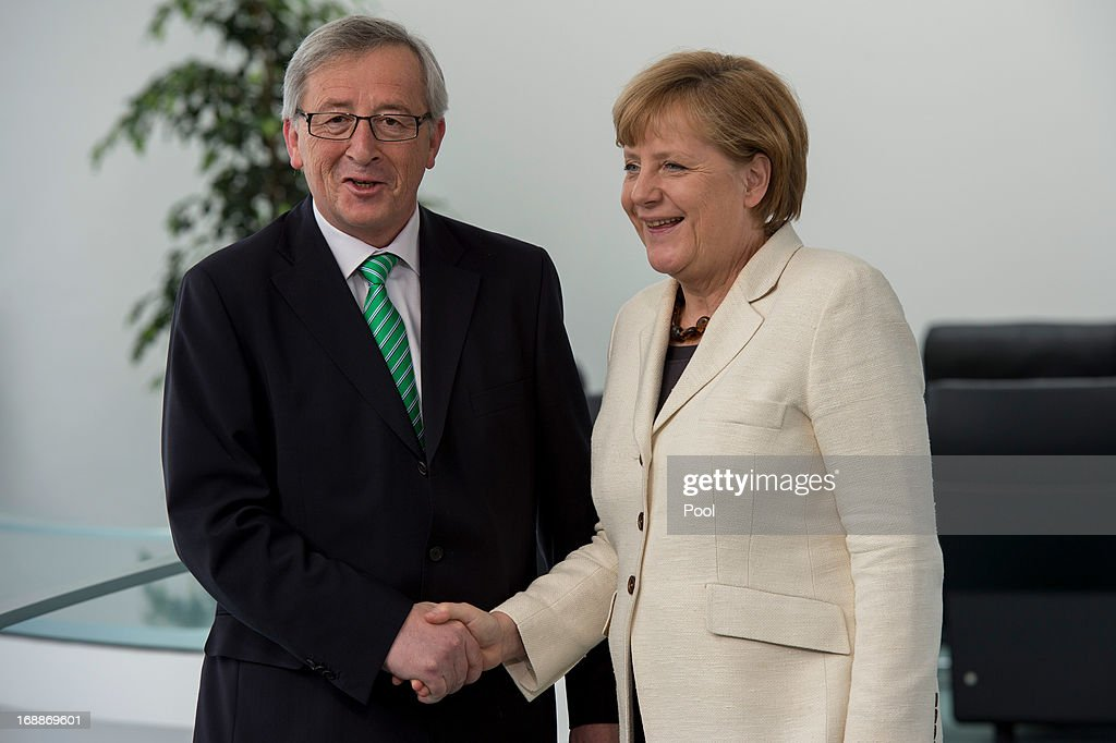 German Chancellor <a gi-track='captionPersonalityLinkClicked' href=/galleries/search?phrase=Angela+Merkel&family=editorial&specificpeople=202161 ng-click='$event.stopPropagation()'>Angela Merkel</a> shakes hands with Luxemburg Prime Minister <a gi-track='captionPersonalityLinkClicked' href=/galleries/search?phrase=Jean-Claude+Juncker&family=editorial&specificpeople=207032 ng-click='$event.stopPropagation()'>Jean-Claude Juncker</a> prior to their meeting at the Chancellery on May 16, 2013 in Berlin, Germany. Merkel and Juncker are meeting ahead of the upcoming EU summit next week, which is to focus heavily on questions of tax evasion by EU citizens and the role of European banks.