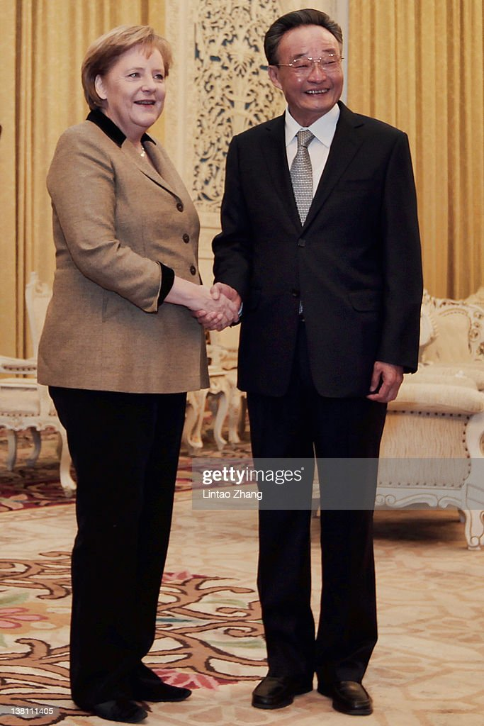 German Chancellor Angela Merkel shakes hands with NPC Chairman Wu Bangguo at the Great Hall of the People on February 3 2012 in Beijing China German...