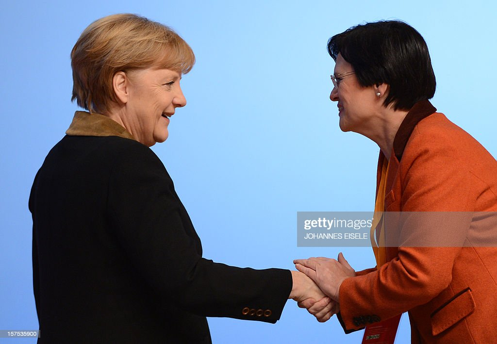 German Chancellor Angela Merkel (L) shakes hands with Thuringia's State Premier Christine Lieberknecht during a congress of Germany's ruling conservative Christian Democratic Union (CDU) party on December 4, 2012 in Hanover, central Germany. Germany's Angela Merkel will rally the rank-and-file of her conservative party at its annual congress running until December 5, eyeing a third term as chancellor of Europe's top economy in elections in the year 2013. AFP PHOTO / JOHANNES EISELE