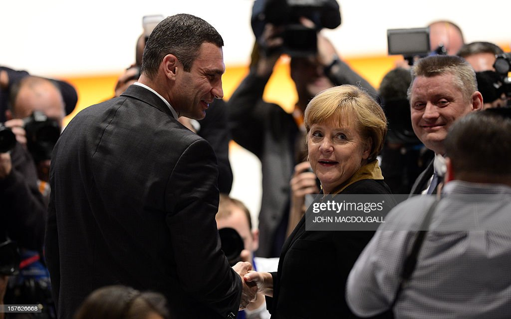 German Chancellor Angela Merkel shakes hands with Ukrainian box champion and member of Ukrainian Parliament Vitali Klitschko during a congress of Germany's ruling conservative Christian Democratic Union (CDU) party on December 4, 2012 in Hanover, central Germany. German Chancellor Angela Merkel was re-elected head of her conservative Christian Democrats (CDU) by more than 97 percent of delegates' votes at a two-day party congress. It was Merkel's best result since she took over as chairman of the CDU in 2000 and comes as she gears up for fighting for a third term at the helm of Europe's top economy in elections expected in September 2013.