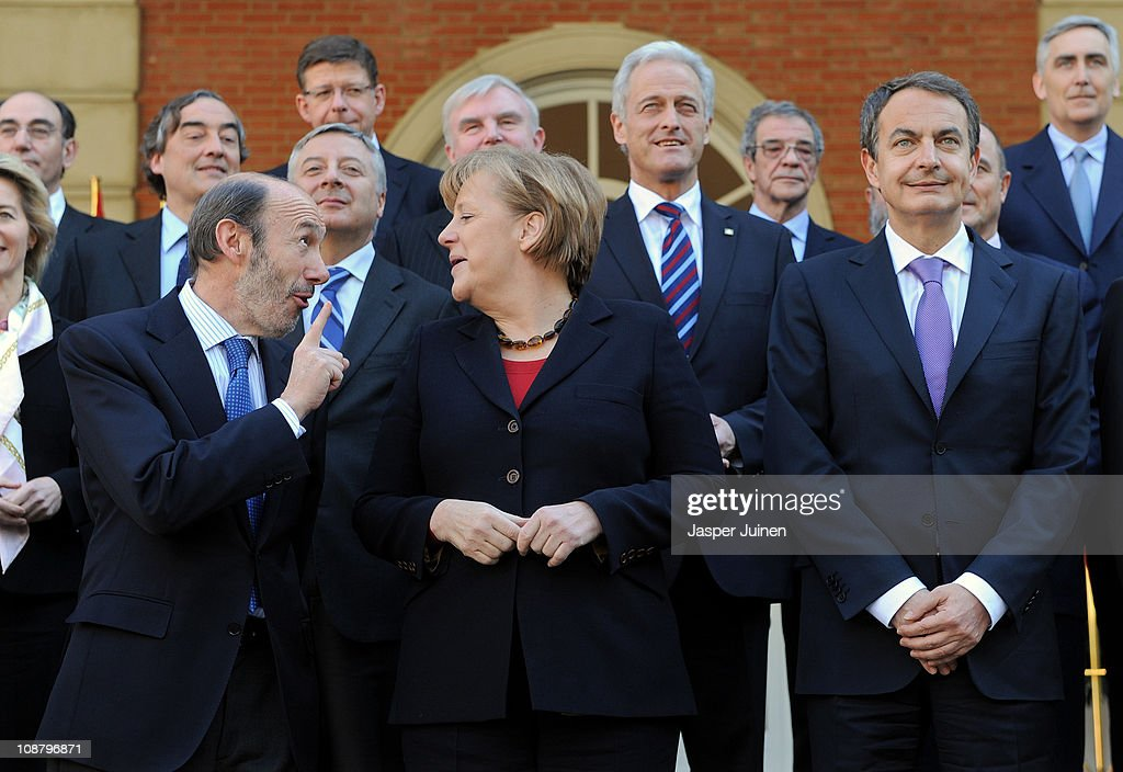 German Chancellor Angela Merkel (C) shares a light moment with Deputy Prime Minister Alfredo Perez Rubalcaba as Spain's Prime Minister Jose Luis Rodriguez Zapatero looks on as they pose for a family photo at La Moncloa Palace on February 3, 2011 in Madrid, Spain. Merkel is visiting Spain with her finance and economy ministers for a one day official visit.