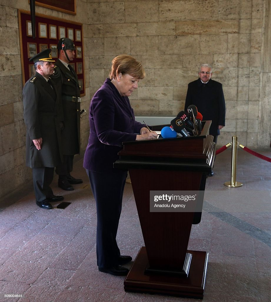 German Chancellor Angela Merkel signs a guest book during her visit to Anitkabir, the mausoleum of Mustafa Kemal Ataturk, founder of the Republic of Turkey, in Ankara, Turkey on February 8, 2016.