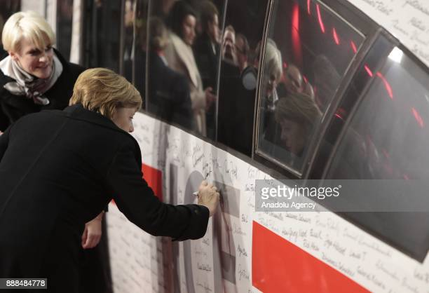 German Chancellor Angela Merkel signs the ICE InterCityExpress Train during the first journey of the high speed track that connect the German's...