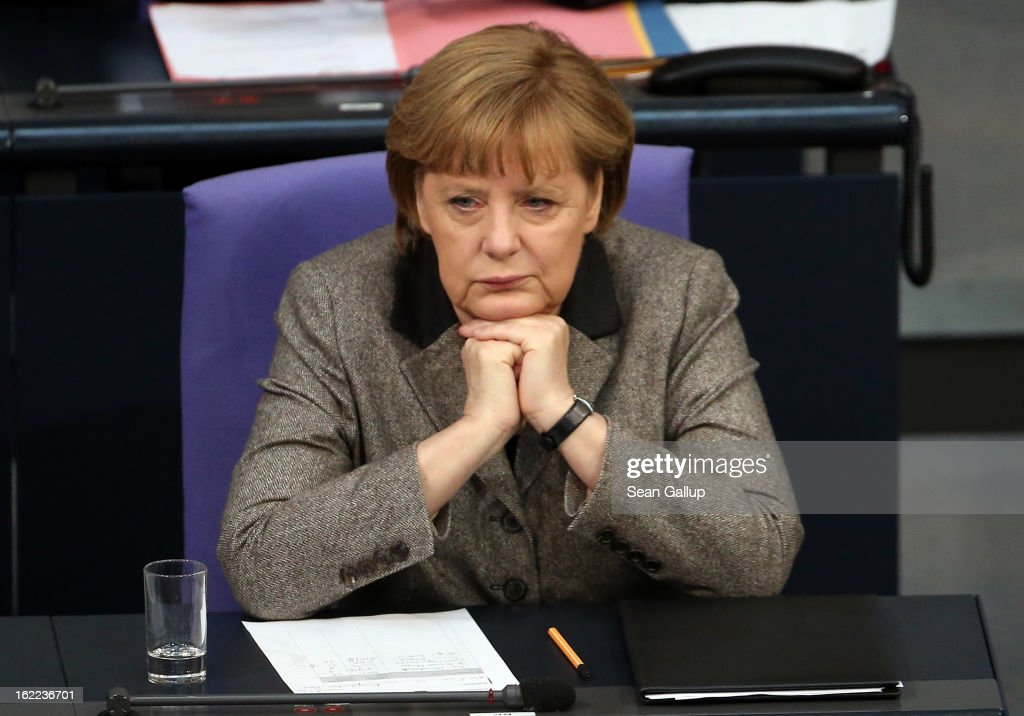 German Chancellor <a gi-track='captionPersonalityLinkClicked' href=/galleries/search?phrase=Angela+Merkel&family=editorial&specificpeople=202161 ng-click='$event.stopPropagation()'>Angela Merkel</a> sits down after giving a government declaration on the forthcoming European Union budget that was agreed upon at a summit in Brussels recently on February 21, 2013 in Berlin, Germany. The budget required wrangling and compromises and will give more money to economically-stricken member state.