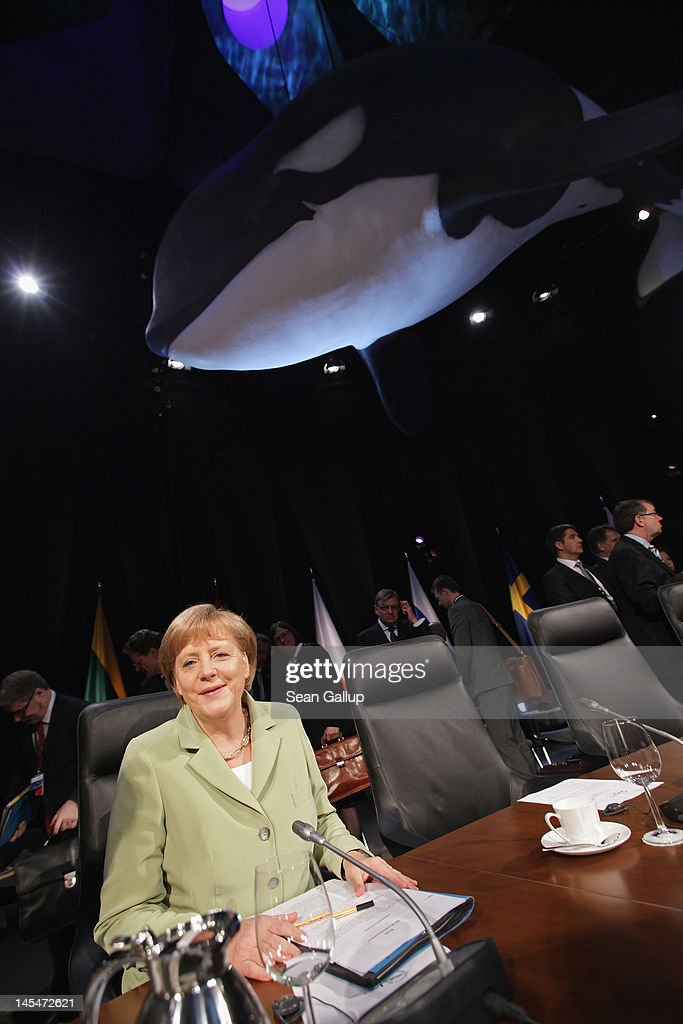 German Chancellor <a gi-track='captionPersonalityLinkClicked' href=/galleries/search?phrase=Angela+Merkel&family=editorial&specificpeople=202161 ng-click='$event.stopPropagation()'>Angela Merkel</a> sits down under a model of a whale hanging from the ceiling at the opening of the 2012 Council of Baltic Sea States Summit at the Ozeaneum maritime museum on May 30, 2012 in Stralsund, Germany. Leaders of the eleven member states as well as representatives of the European Union are meeting to discuss matters related to energy, the environment and economic development during the two-day summit.