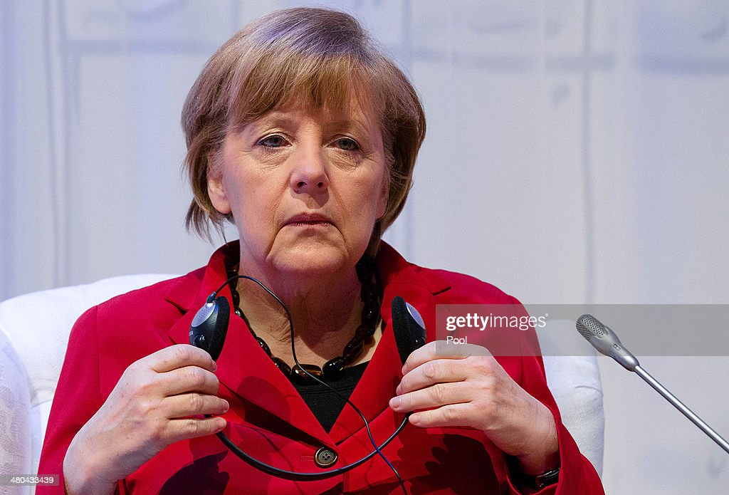 German Chancellor Angela Merkel sits for an informal plenary session of the 2014 Nuclear Security Summit on March 25, 2014 in The Hague, Netherlands. Leaders from around the world have come to discuss matters related to international nuclear security, though the summit has been overshadowed by recent events in Ukraine.