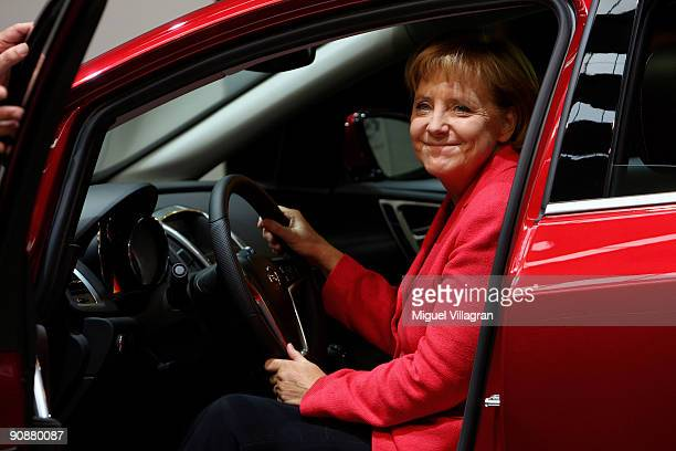 German Chancellor Angela Merkel sits inside a Opel Astra car at the Opel tradeshow booth during the international motor show IAA on September 17 2009...