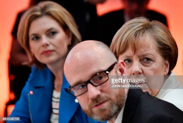 German Chancellor Angela Merkel sits next to Deputy Chairwoman of the Christian Democratic Union's CDU Julia Kloeckner and CDU Secreaty General Peter...