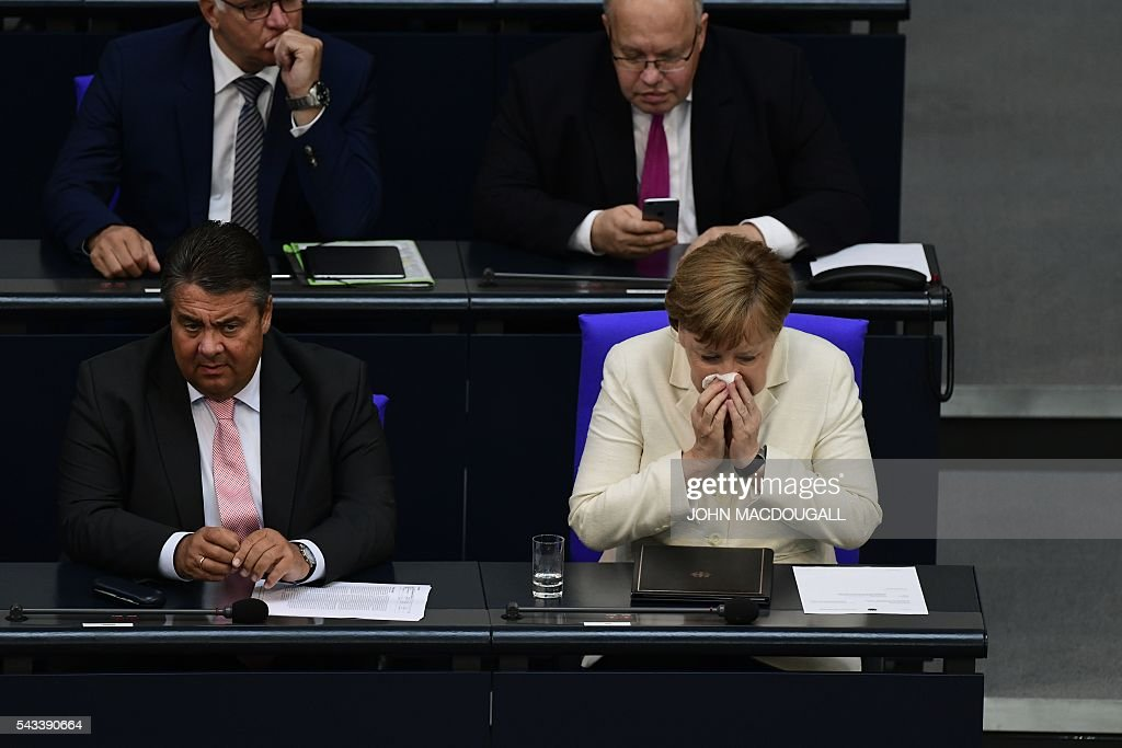German Chancellor Angela Merkel sits next to German Vice Chancellor, Economy and Energy Minister Sigmar Gabriel before joining a special plenary session on Brexit at the German lower house of Parliament Bundestag in Berlin, on June 28, 2016. Merkel outlines to parliament her vision for the future of Europe following Britain's decision to leave the EU. / AFP / John MACDOUGALL