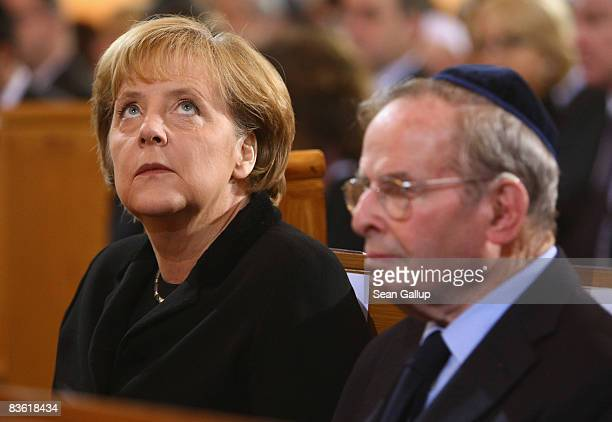 German Chancellor Angela Merkel sits next to publisher and Kristallnacht eyewitness Ernst Cramer at a commemorative service for the 70th anniversary...
