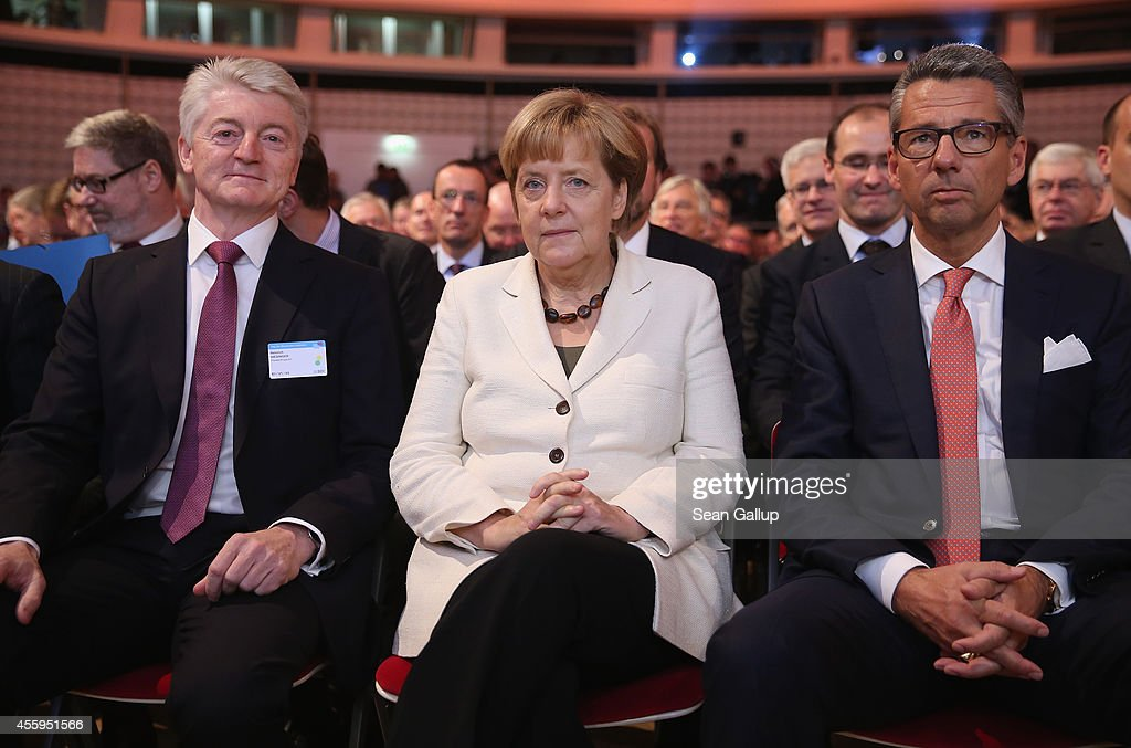 German Chancellor Angela Merkel sits next to ThyssenKrupp Chairman Heinrich Hiesinger and BDI President Ulrich Grillo at the annual congress of the...