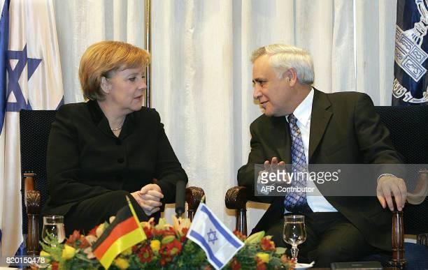 German Chancellor Angela Merkel sits speaking with Israeli president Moshe Katsav 30 January 2006 at his residence in JerusalemIsrael was looking to...