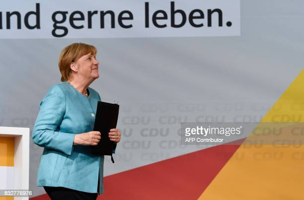 German Chancellor Angela Merkel smiles after addressing an election campaign rally of the Christian Democratic Union in Heilbronn southern Germany on...