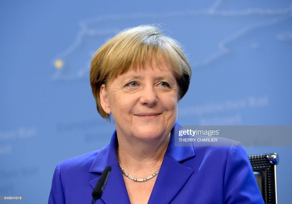 German Chancellor Angela Merkel smiles as she addresses the media at the end of the second day of an EU - Summit at the EU headquarters in Brussels on June 29, 2016. EU leaders agreed on June 29 that Britain cannot have access to the single market after leaving the union without accepting the bloc's rules on free movement, president Donald Tusk said. / AFP / THIERRY