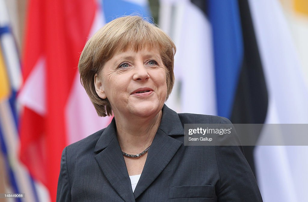 German Chancellor <a gi-track='captionPersonalityLinkClicked' href=/galleries/search?phrase=Angela+Merkel&family=editorial&specificpeople=202161 ng-click='$event.stopPropagation()'>Angela Merkel</a> smiles as she arrives at the 2012 Council of Baltic Sea States Summit on May 30, 2012 in Stralsund, Germany. Leaders of the eleven member states as well as representatives of the European Union are meeting to discuss matters related to energy, the environment and economic development during the two-day summit.