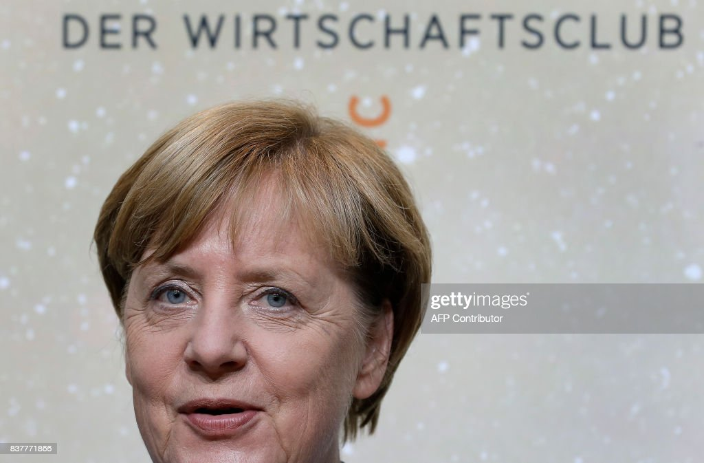 German Chancellor Angela Merkel smiles as she arrives for the 'Deutschland Live' (Germany Live) event organized by the economy news paper 'Handelsblatt' in Berlin, Germany,on August 23, 2017. / AFP PHOTO / POOL / Michael Sohn