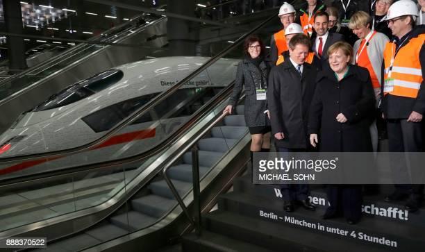 German Chancellor Angela Merkel smiles as she attends a family photo with Chairman of German railway operator Deutsche Bahn Richard Lutz and Deutsche...