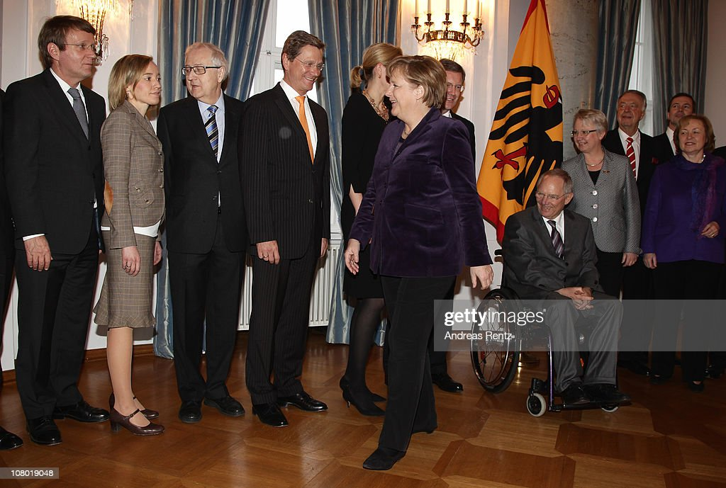 German Chancellor <a gi-track='captionPersonalityLinkClicked' href=/galleries/search?phrase=Angela+Merkel&family=editorial&specificpeople=202161 ng-click='$event.stopPropagation()'>Angela Merkel</a> (front) smiles as she walks past German Vice Chancellor and Foreign Minister <a gi-track='captionPersonalityLinkClicked' href=/galleries/search?phrase=Guido+Westerwelle&family=editorial&specificpeople=208748 ng-click='$event.stopPropagation()'>Guido Westerwelle</a>, German Economy Minister <a gi-track='captionPersonalityLinkClicked' href=/galleries/search?phrase=Rainer+Bruederle&family=editorial&specificpeople=2146238 ng-click='$event.stopPropagation()'>Rainer Bruederle</a> and German Family Minister Kristina Schroeder during the New Year's reception at Bellevue Palace on January 13, 2011 in Berlin, Germany. German President Christian Wulff invites guests from all groups of the society for the annual New Year's reception.