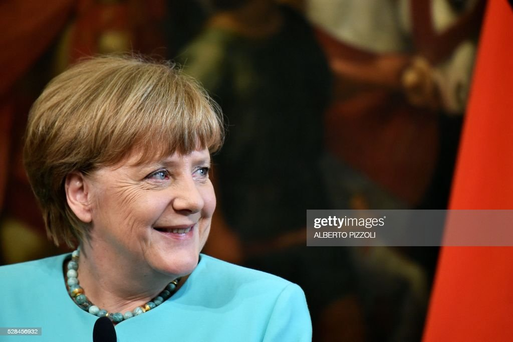 German Chancellor Angela Merkel smiles during a news conference together with Italian Prime Minister in Rome's Palazzo Chigi on May 5, 2016. EU president Donald Tusk travels to Rome Thursday with fellow EU institution leaders and German Chancellor Angela Merkel for two days of talks likely to focus on next steps in Europe's migrant crisis. Prime Minister Matteo Renzi, who fears Italy becoming the new migrant frontline after the closure of the Balkan route, will host the first day of talks, followed by Pope Francis on Friday. PIZZOLI