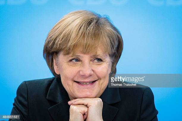 German Chancellor Angela Merkel smiles during the Federal Committee of the CDU on December 09 2013 at the Hotel Intercontinental in Berlin Germany...