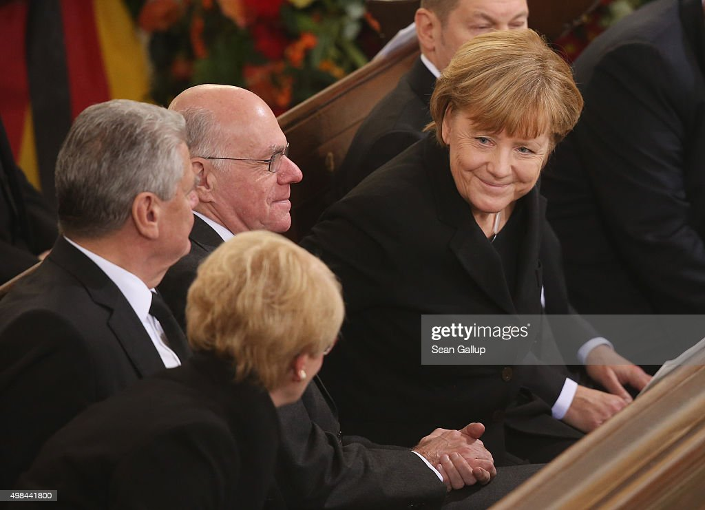 German Chancellor <a gi-track='captionPersonalityLinkClicked' href=/galleries/search?phrase=Angela+Merkel&family=editorial&specificpeople=202161 ng-click='$event.stopPropagation()'>Angela Merkel</a> (R) smiles to Susanne Schmidt, daughter of Helmut Schmidt, as German President <a gi-track='captionPersonalityLinkClicked' href=/galleries/search?phrase=Joachim+Gauck&family=editorial&specificpeople=2077888 ng-click='$event.stopPropagation()'>Joachim Gauck</a> (L) and Bundestag President <a gi-track='captionPersonalityLinkClicked' href=/galleries/search?phrase=Norbert+Lammert&family=editorial&specificpeople=575522 ng-click='$event.stopPropagation()'>Norbert Lammert</a> look on at the state funeral of former German Chancellor Helmut Schmidt at Sankt Michaelis church on November 23, 2015 in Hamburg, Germany. Schmidt, a German Social Democrat (SPD), led West Germany as chancellor from 1974 until 1982. He died on November 10 in Hamburg at the age of 96.