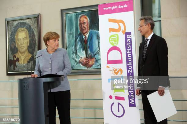 German Chancellor Angela Merkel speaks as Hannes Schwaderer president of the D21 initiative looks on on Girls' Day on April 26 2017 in Berlin Germany...