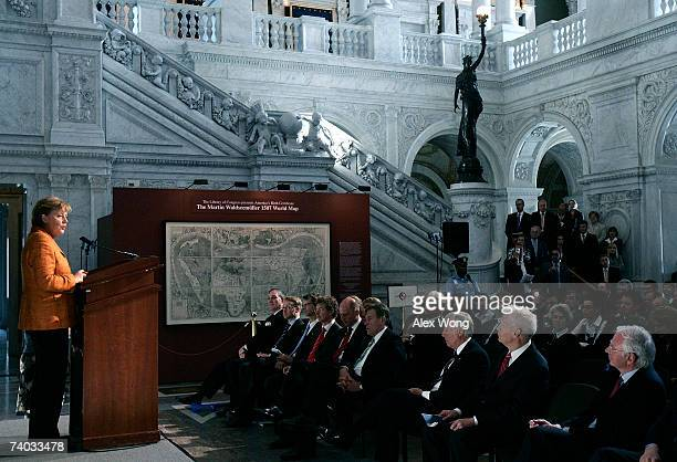 German Chancellor Angela Merkel speaks at a ceremony to officially transfer Martin Waldseemuller's 1507 World Map to the US Government on April 30...
