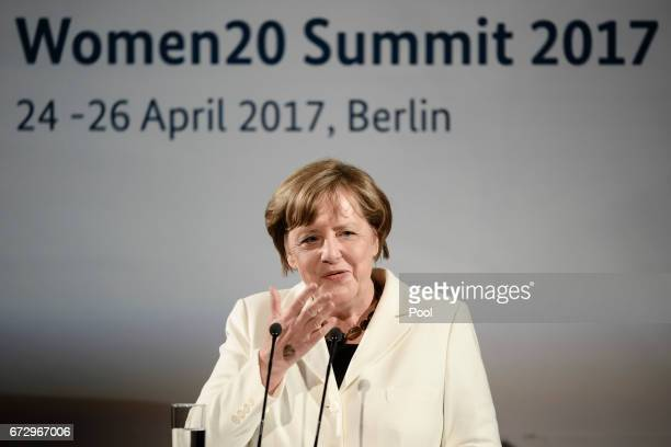 German Chancellor Angela Merkel speaks at a Gala Dinner at Deutsche Bank within the framework of the W20 summit on April 25 2017 in Berlin Germany...