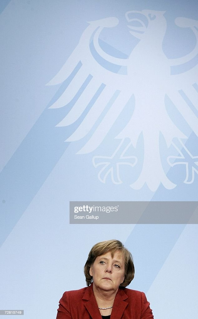 German Chancellor <a gi-track='captionPersonalityLinkClicked' href=/galleries/search?phrase=Angela+Merkel&family=editorial&specificpeople=202161 ng-click='$event.stopPropagation()'>Angela Merkel</a> speaks at a press conference after a meeting of German state governors at the Chancellery December 13, 2006 in Berlin, Germany. State governors from across Germany met in Berlin to discuss, among other issues, reforms to the German federal system as well as a national ban on smoking in restaurants, bars, hospitals and schools. Recent legislation failed after lawmakers could not decide whether the ban is a federal or state-level issue.