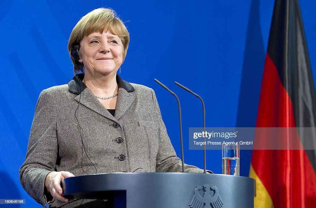 German Chancellor <a gi-track='captionPersonalityLinkClicked' href=/galleries/search?phrase=Angela+Merkel&family=editorial&specificpeople=202161 ng-click='$event.stopPropagation()'>Angela Merkel</a> speaks at a press conference during the reception of the Spanish Prime Minister Mariano Rajoy at the Chancellery on February 4, 2013 in Berlin, Germany. The German and Spanish government are meeting for consultations, and the ongoing spanish economic downturn is likely to be high on the agenda.