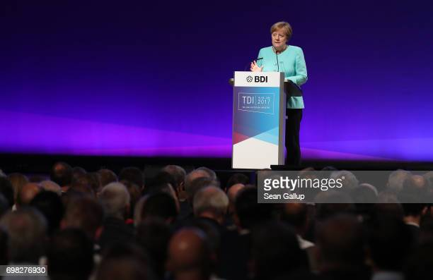 German Chancellor Angela Merkel speaks at the annual congress of the Federation of German Industry on June 20 2017 in Berlin Germany Merkel as well...
