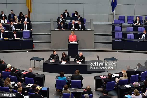 German Chancellor Angela Merkel speaks at the Bundestag the German lower house of parliament in Berlin on July 17 2015 German lawmakers will vote...