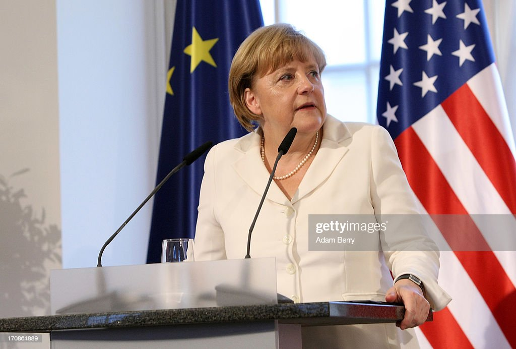 German Chancellor <a gi-track='captionPersonalityLinkClicked' href=/galleries/search?phrase=Angela+Merkel&family=editorial&specificpeople=202161 ng-click='$event.stopPropagation()'>Angela Merkel</a> speaks during a dinner at the Orangerie at Schloss Charlottenburg palace on June 19, 2013 in Berlin, Germany. U.S. President Barack Obama is visiting Berlin for the first time during his presidency and his speech at the Brandenburg Gate is to be the highlight. Obama spoke close to the 50th anniversary of the historic speech by then U.S. President John F. Kennedy in Berlin in 1963, during which he proclaimed the famous sentence: 'Ich bin ein Berliner.'
