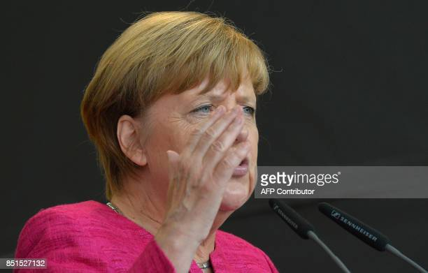 German Chancellor Angela Merkel speaks during an election campaign rally of the Christian Democratic Union in Ulm southern Germany on September 22...
