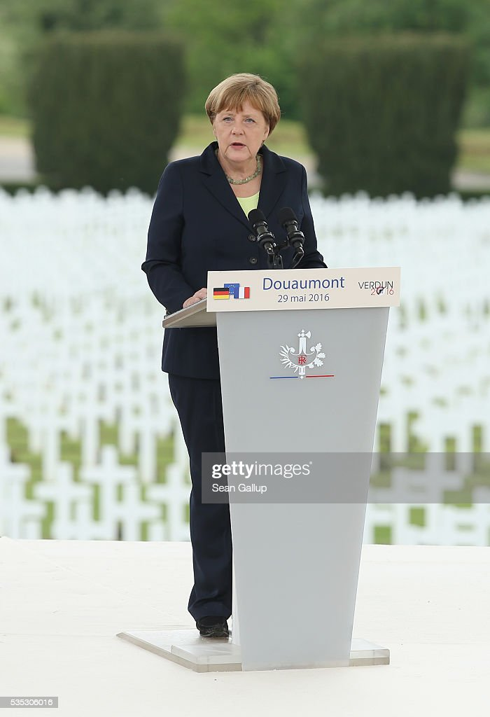 German Chancellor Angela Merkel speaks during ceremonies to commemorate the 100th anniversary of the World War I Battle of Verdun at the Douaumont cemetery on May 29, 2016 near Verdun, France. The 1916, 10-month battle pitted the French and German armies against one another in a grueling campaign of trench warfare and artillery bombardments that killed a total of approximately 300,000 soldiers. The events today coincide with the 50th anniversary of commemorations held at Verdun by then French President Charles de Gaulle and German Chancellor Konrad Adenauer that paved the way for a new era of peaceful, post-war Franco-German relations.