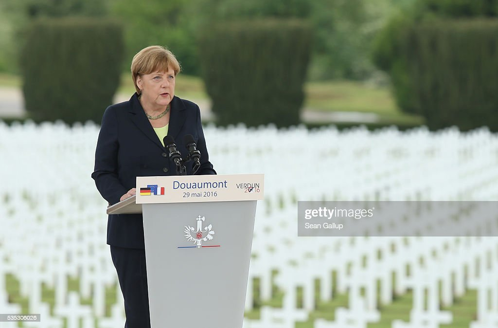 German Chancellor <a gi-track='captionPersonalityLinkClicked' href=/galleries/search?phrase=Angela+Merkel&family=editorial&specificpeople=202161 ng-click='$event.stopPropagation()'>Angela Merkel</a> speaks during ceremonies to commemorate the 100th anniversary of the World War I Battle of Verdun at the Douaumont cemetery on May 29, 2016 near Verdun, France. The 1916, 10-month battle pitted the French and German armies against one another in a grueling campaign of trench warfare and artillery bombardments that killed a total of approximately 300,000 soldiers. The events today coincide with the 50th anniversary of commemorations held at Verdun by then French President Charles de Gaulle and German Chancellor Konrad Adenauer that paved the way for a new era of peaceful, post-war Franco-German relations.