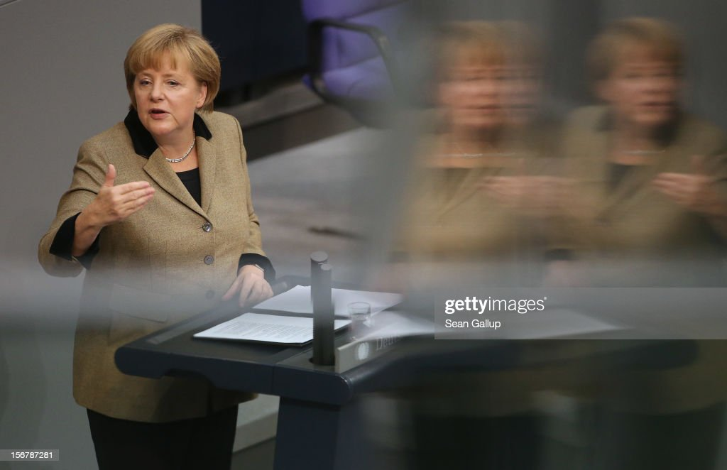 German Chancellor <a gi-track='captionPersonalityLinkClicked' href=/galleries/search?phrase=Angela+Merkel&family=editorial&specificpeople=202161 ng-click='$event.stopPropagation()'>Angela Merkel</a> speaks during debates at the Bundestag over the 2013 federal budget on November 21, 2012 in Berlin, Germany. Bundestag members are debating the budget over four days this week.