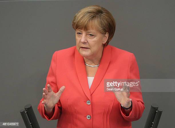 German Chancellor Angela Merkel speaks during debates prior to a vote over the third EU financial aid package to Greece at an extraordinary session...