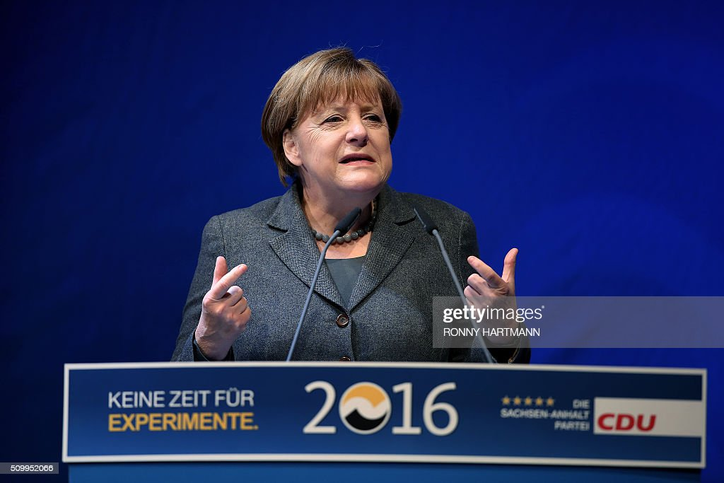 German Chancellor Angela Merkel speaks during the launch of the election campaign of the Christian Democratic Union (CDU) party for state elections in Magdeburg, eastern Germany, on February 13, 2016. Regional elections in three German federal states - Saxony-Anhalt, Rhineland Palatinate and Baden-Wuerttemberg - will take place on March 13, 2016. / AFP / Ronny Hartmann
