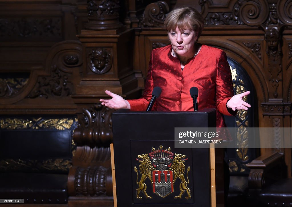 German Chancellor Angela Merkel speaks during the Matthiae Dinner attended by British Prime Minister David Cameron in Hamburg, northern Germany on February 12, 2016. / AFP / CARMEN JASPERSEN