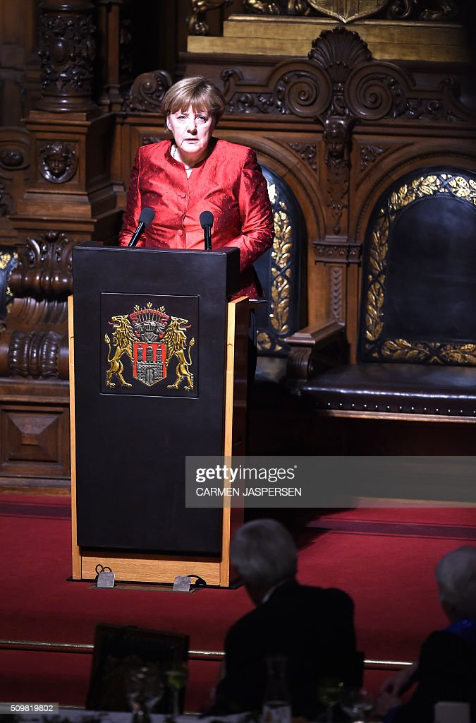 German Chancellor Angela Merkel speaks during the Matthiae-Mahl Dinner attended by British Prime Minister David Cameron in Hamburg, northern Germany on February 12, 2016. / AFP / CARMEN JASPERSEN