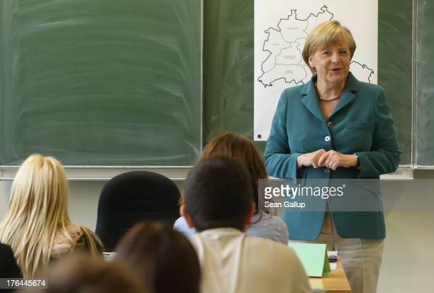 German Chancellor Angela Merkel speaks to 12th grade high school students about the construction of the Berlin Wall in 1961 at the...