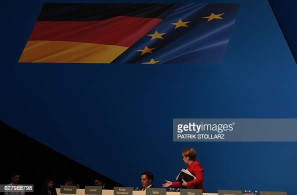 German Chancellor Angela Merkel speaks to David McAllister Christian Democratic Union board member during her conservative Christian Democratic Union...
