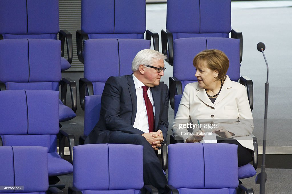 German Chancellor Angela Merkel speaks to German Foreign Minister FrankWalter Steinmeier at Bundestag the German federal Parliament on April 04 2014...