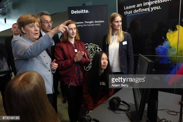 German Chancellor Angela Merkel speaks to participants at the Deloitte stand at Girls' Day on April 26 2017 in Berlin Germany The event is meant to...