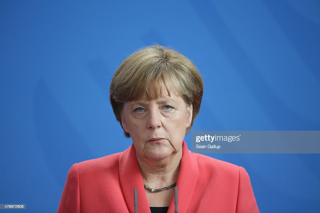 German Chancellor <a gi-track='captionPersonalityLinkClicked' href=/galleries/search?phrase=Angela+Merkel&family=editorial&specificpeople=202161 ng-click='$event.stopPropagation()'>Angela Merkel</a> speaks to the media following an extraordinary meeting with leaders of Germany's main political parties at the Chancellery the day after the European Central Bank announced it would not extend emergency funding to Greece on June 29, 2015 in Berlin, Germany. Stock markets in Europe were markedly down today and the Greek government ordered cash machines turned off and a tightening on the flow of capital in an effort to staunch citizens' withdrawals.