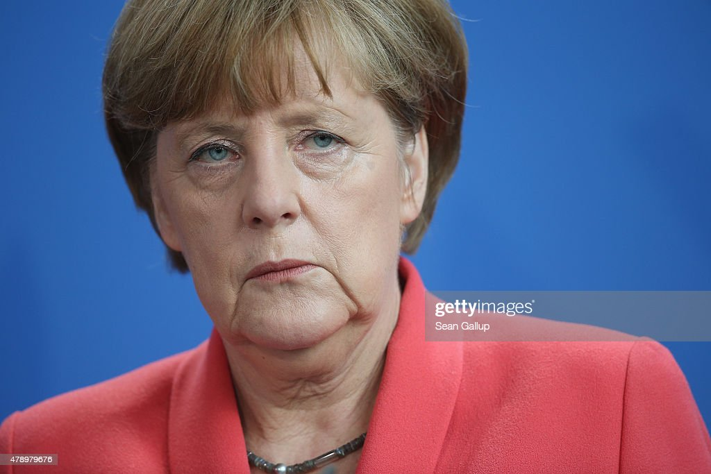 German Chancellor Angela Merkel speaks to the media following an extraordinary meeting with leaders of Germany's main political parties at the Chancellery the day after the European Central Bank announced it would not extend emergency funding to Greece on June 29, 2015 in Berlin, Germany. Stock markets in Europe were markedly down today and the Greek government ordered cash machines turned off and a tightening on the flow of capital in an effort to staunch citizens' withdrawals.