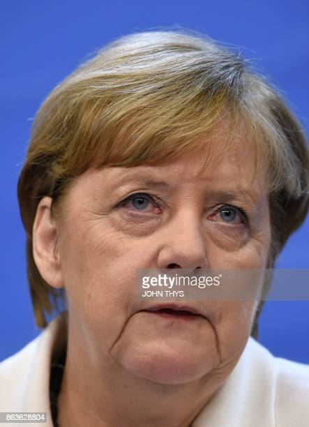 German Chancellor Angela Merkel speaks to the press at the end of the EU leaders' summit at the building Council of the EU in Brussels on October 20...