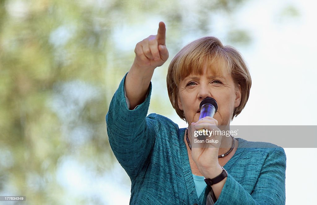 German Chancellor Angela Merkel speaks to visitors during the annual open-house day at the Chancellery on August 25, 2013 in Berlin, Germany. Germany is facing federal elections scheduled for September 22 and so far the CDU has a substantial lead in polls over the opposition.
